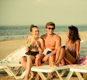 Multi ethnic friends on a beach Royalty Free Stock Photos