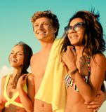 Multi ethnic friends on a beach Stock Image