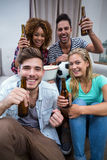 Multi-ethnic friends cheering while watching soccer match. Portrait of happy multi-ethnic friends cheering while watching soccer match Stock Images