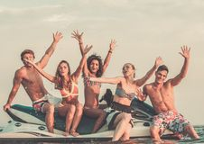 Multi ethnic friends on a jet ski stock photo