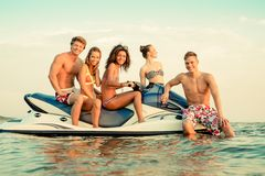 Multi ethnic friends on a jet ski stock photos