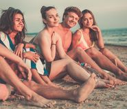 Multi ethnic friends  relaxing on a beach Royalty Free Stock Photos