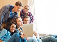 Multi ethnic friends taking selfie. Group of young multi ethnic friends taking selfie in home interior Stock Image
