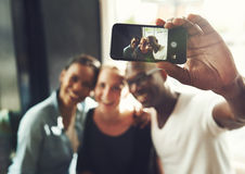 Multi ethnic friends taking a selfie stock photos