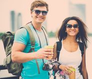 Multi-ethnic friends tourists in a city Royalty Free Stock Photo
