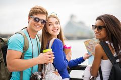 Multi-ethnic friends tourists in a city Royalty Free Stock Photos