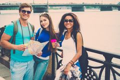 Multi-ethnic friends tourists in a city Stock Image