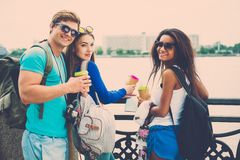 Multi-ethnic friends tourists in a city Stock Photos