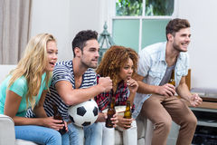 Multi-ethnic friends watching soccer match Stock Photography