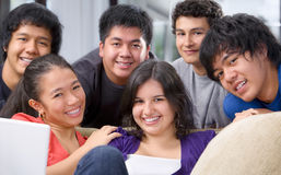 Multi ethnic friendship. Multi ethnic teenagers pose together Royalty Free Stock Photos