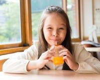Multi-ethnic girl drinking juice Stock Images