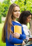 Multi ethnic girls in a park Stock Image
