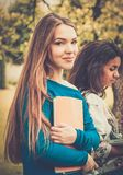 Multi ethnic girls in a park Stock Images
