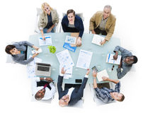 Multi-Ethnic Group Of Business People. In Fiancial Meeting Stock Photo