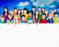 Multi-Ethnic Group of Children Holding Billboard Concept Stock Photo