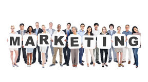 Multi-Ethnic Group Of Diverse People Holding Texts Marketing. Multi-Ethnic Group Of Diverse People Holding Letters That Form Marketing Stock Photography