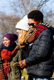 Multi-ethnic group of five young people having fun at barbecue. In winter Royalty Free Stock Photo
