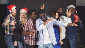 Multi ethnic group friends dancing and having fun at Christmas party. stock footage