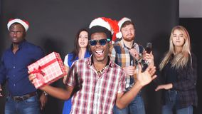 Multi ethnic group friends dancing and having fun at Christmas party. Slow motion stock video