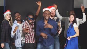 Multi ethnic group friends dancing laughing smiling and having fun at party in studio. stock video