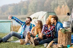 Friends during the outdoor recreation. Multi ethnic group of friends dressed casually having fun making a selfie photo together during the outdoor recreation Royalty Free Stock Photos