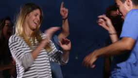 Multi-ethnic group of friends having fun dancing on the rooftop terrace. Happy multi-ethnic group of friends having fun dancing on the rooftop terrace stock footage