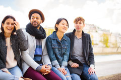 Multi-ethnic Group Of Friends Having Fun In Paris Along Seine Royalty Free Stock Photos