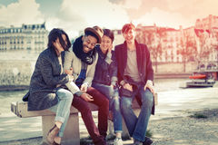 Multi-ethnic Group Of Friends Having Fun In Paris Along Seine Stock Image