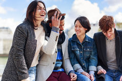 Multi-ethnic Group Of Friends Having Fun In Paris Along Seine Stock Photo