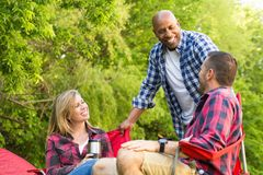 Multi-ethnic group of friends laughing and talking. Royalty Free Stock Images