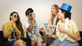 Friends are at a party. Celebrating the Brazilian Carnaval. Grou. Multi ethnic group of friends are making Carnaval party. Euphoria in Brazil. They are wearing Stock Photography