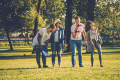 Multi-ethnic group of friends in a park Stock Images
