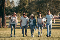 Multi-ethnic group of friends in a park Royalty Free Stock Images