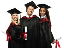 Multi ethnic group of graduated students Stock Photography
