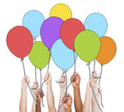 Multi-Ethnic Group of Hands Holding Balloons Royalty Free Stock Images