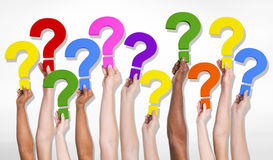 Multi-Ethnic Group of Human Hands Holding Question Marks Royalty Free Stock Images