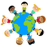 Multi ethnic group of kids standing around the earth Royalty Free Stock Image