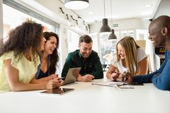 Free Multi-ethnic Group Of Young People Studying Together On White De Stock Photography - 125652462