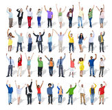 Multi-Ethnic Group of People with Arms Raised Stock Photo