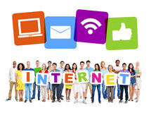 Multi-Ethnic Group Of People Holding Alphabet To Form Internet. And Internet Themed Images Above royalty free stock photo