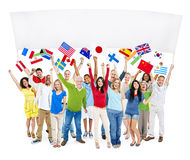 Multi-Ethnic Group Of People Holding Blank Billboard An. D National Flags Stock Photos