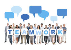 Multi-Ethnic Group of People Holding Cardboard Teamwork Royalty Free Stock Photography