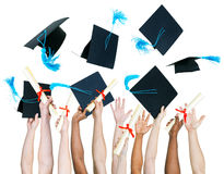 Multi-ethnic group of people holding certificate and throwing gr Stock Images