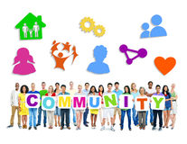 Multi-Ethnic Group Of People Holding Community. Multi-Ethnic Group Of People Holding 9 Placards Forming Community And Related Symbols Above Stock Photography