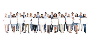 Multi-Ethnic Group Of People Holding Empty Cardboards. Multi-Ethnic Group Of Business And Casual People Holding 12 Letters Empty Cardboards Stock Images