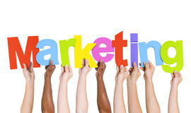 Multi-Ethnic Group Of People Holding Marketing. Multi-Ethnic Group Of People Holding The Word Marketing Stock Image