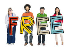 Multi-Ethnic Group of People Holding Text Freedom Stock Image