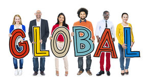 Multi-Ethnic Group of People Holding Text Global Royalty Free Stock Image