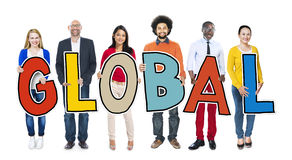 Multi-Ethnic Group of People Holding Text Global.  royalty free stock image