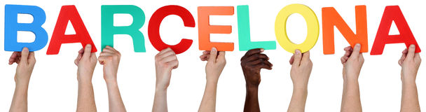 Multi ethnic group of people holding the word Barcelona Stock Image